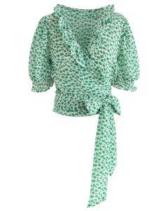 Attachez un haut gainé de fleurs bowknot en vert