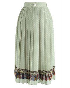 Je t'aime jupe mi-longue à pois plissés en vert