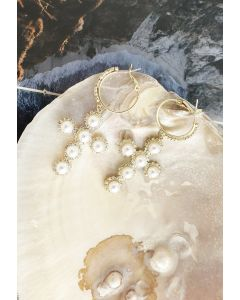 Pendants d'oreilles croisés ornés de perles